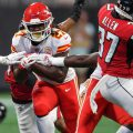 Kansas City Chiefs running back Kareem Hunt (27) runs against the Atlanta Falcons defense during the first quarter at Mercedes-Benz Stadium.