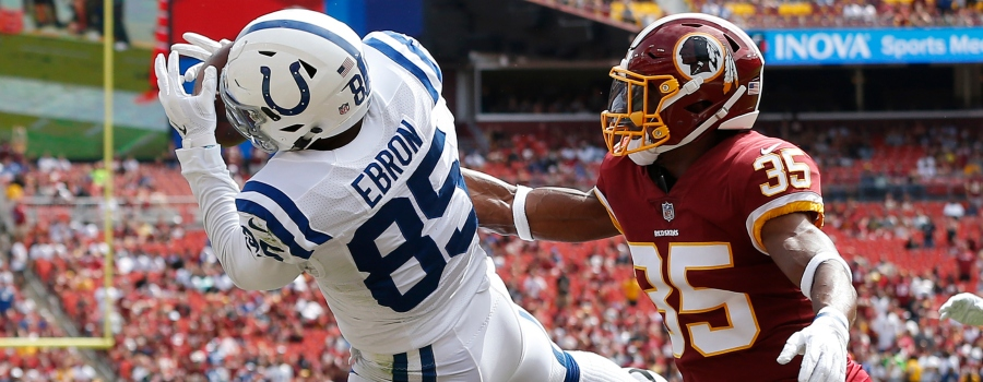 Indianapolis Colts tight end Eric Ebron (85) catches a touchdown pass as Washington Redskins defensive back Montae Nicholson (35) defends in the first quarter at FedEx Field.