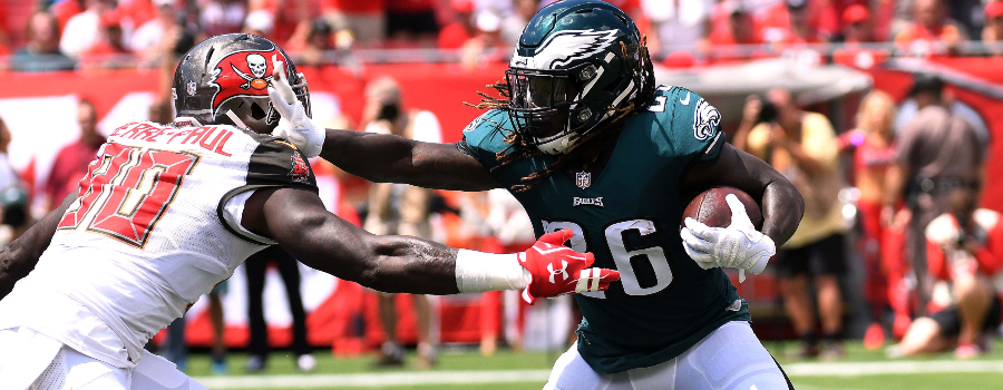 Philadelphia Eagles running back Jay Ajayi (26) tries to get past Tampa Bay Buccaneers defensive lineman Jason Pierre-Paul (90) in the first half at Raymond James Stadium.