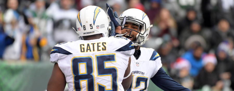 Los Angeles Chargers tight end Antonio Gates (85) celebrates with receiver Keenan Allen (13) after scoring on a 3-yard touchdown pass in the second quarter against the New York Jets during an NFL football game at MetLife Stadium.