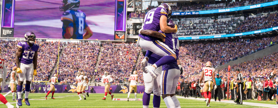 Minnesota Vikings wide receiver Adam Thielen (19) celebrates with wide receiver Stefon Diggs (14) after his touchdown in the second quarter against San Francisco 49ers at U.S. Bank Stadium.