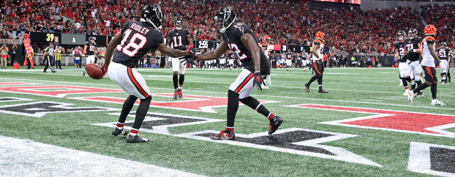 Atlanta Falcons wide receiver Calvin Ridley (18) celebrates with wide receiver Mohamed Sanu (12) after a catching a pass for a touchdown against the Cincinnati Bengals in the second quarter at Mercedes-Benz Stadium.