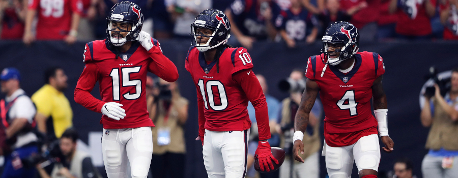 Houston Texans wide receiver DeAndre Hopkins (10) celebrates with wide receiver Will Fuller (15) and quarterback Deshaun Watson (4) after catching a touchdown pass against the Buffalo Bills during the first quarter at NRG Stadium.