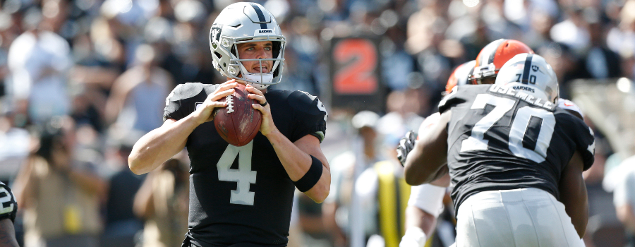Oakland Raiders quarterback Derek Carr (4) looks to throw a pass against the Cleveland Browns in the first quarter at Oakland Coliseum.