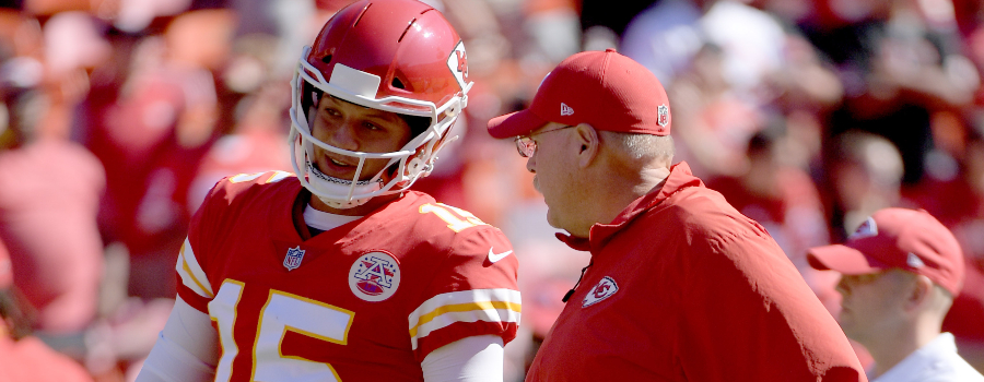 Kansas City Chiefs quarterback Patrick Mahomes (15) talks with head coach Andy Reid