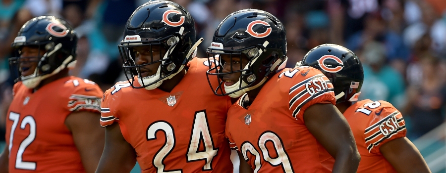 Chicago Bears running back Tarik Cohen (29) reacts next to Chicago Bears running back Jordan Howard (24) against the Miami Dolphins during the second half at Hard Rock Stadium.