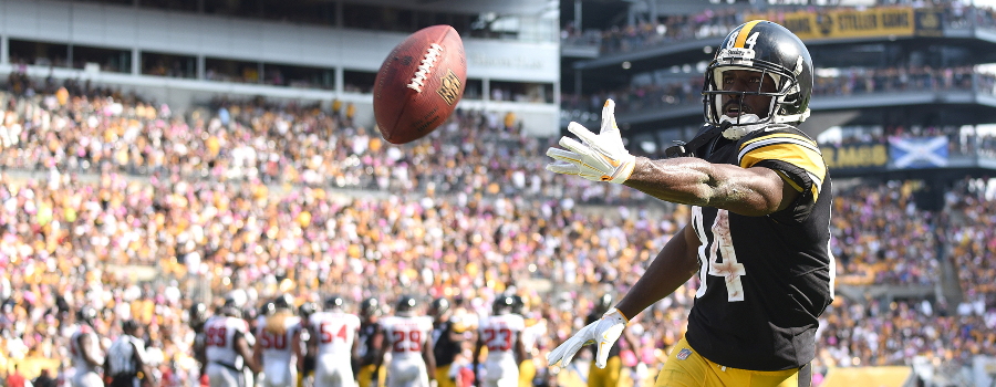 Pittsburgh Steelers wide receiver Antonio Brown (84) tosses the ball to a fan after scoring a third quarter touchdown against the Atlanta Falcons at Heinz Field.
