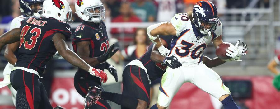 Denver Broncos running back Phillip Lindsay (30) scores a third quarter touchdown against the Arizona Cardinals at State Farm Stadium.