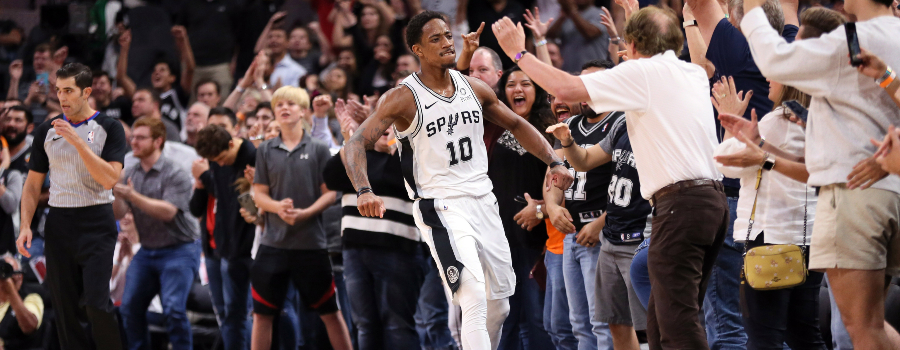San Antonio Spurs shooting guard DeMar DeRozan (10) reacts after a shot during overtime against the Dallas Mavericks at AT&T Center.