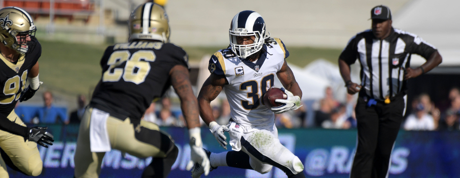 Los Angeles Rams running back Todd Gurley (30) is pursued by New Orleans Saints cornerback P.J. Williams (26) and defensive end Trey Hendrickson (91) during an NFL football game at Los Angeles Memorial Coliseum.