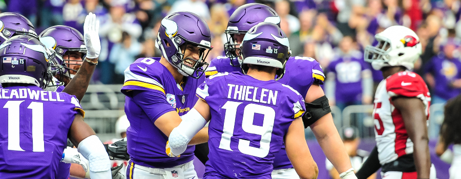 Minnesota Vikings quarterback Kirk Cousins (8) reacts with wide receiver Adam Thielen (19) after the two connected on a 13 yard touchdown pass during the third quarter against the Arizona Cardinals at U.S. Bank Stadium.