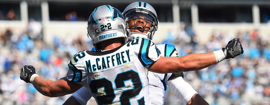 Christian McCaffrey (22) celebrates with quarterback Cam Newton (1) after scoring a touchdown in the fourth quarter at Bank of America Stadium.