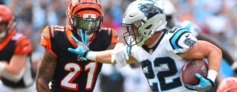 Carolina Panthers running back Christian McCaffrey (22) with the ball as Cincinnati Bengals defensive back Darqueze Dennard (21) defends in the second quarter at Bank of America Stadium.