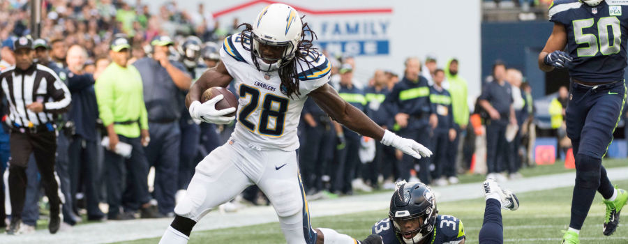 Los Angeles Chargers running back Melvin Gordon (28) breaks a tackle by Seattle Seahawks free safety Tedric Thompson (33) and later scores a touchdown during the first half at CenturyLink Field.