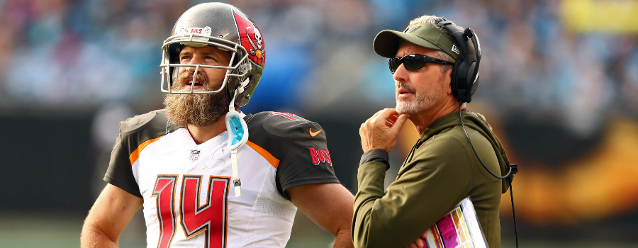 Tampa Bay Buccaneers quarterback Ryan Fitzpatrick (14) talks with head coach Dirk Koetter during the fourth quarter against the Carolina Panthers at Bank of America Stadium.