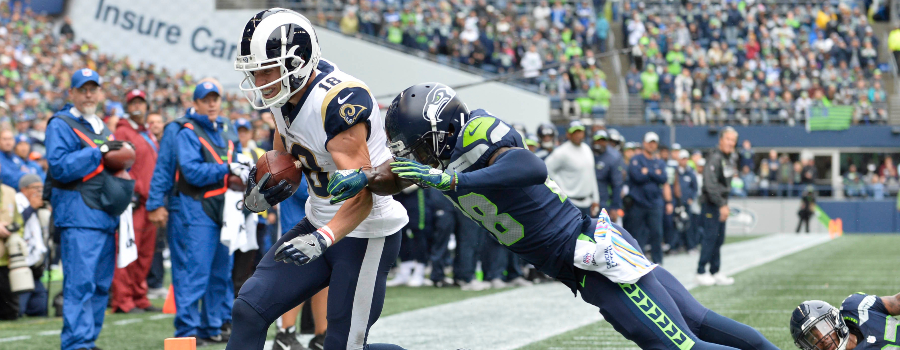 Los Angeles Rams wide receiver Cooper Kupp (18) scores a touchdown against the Seattle Seahawks during the first half at CenturyLink Field.