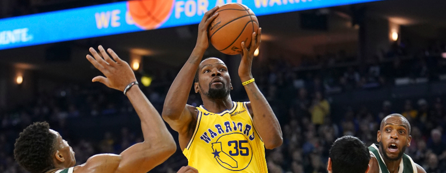 Golden State Warriors forward Kevin Durant (35) shoots the basketball against Milwaukee Bucks forward Giannis Antetokounmpo (34) and forward Ersan Ilyasova (77) during the second quarter at Oracle Arena.