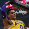 Los Angeles Lakers forward Kyle Kuzma (0) dunks the ball against Sacramento Kings forward Marvin Bagley III (35) during the first quarter at Golden 1 Center.