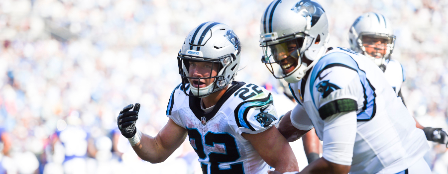 Carolina Panthers running back Christian McCaffrey (22) celebrates with quarterback Cam Newton (1) after scoring a touchdown in the fourth quarter at Bank of America Stadium.