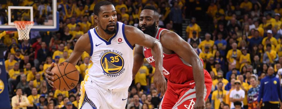 e5ff7bebb64d Golden State Warriors forward Kevin Durant (35) dribbles past Houston  Rockets guard James Harden