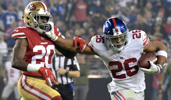 New York Giants running back Saquon Barkley (26) is defended by San Francisco 49ers cornerback Jimmie Ward (20)in the second quarter at Levi's Stadium.