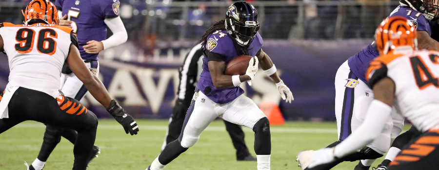 Baltimore Ravens running back Alex Collins (34) runs for a gain against the Cincinnati Bengals at M&T Bank Stadium.
