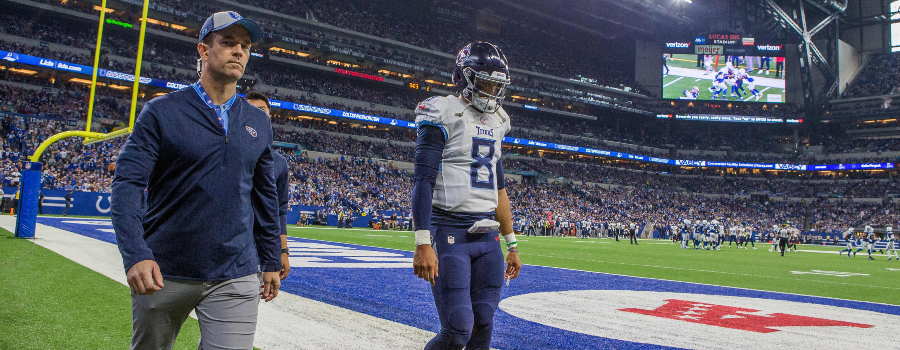 Tennessee Titans quarterback Marcus Mariota (8) walks back to the locker room after suffering an apparent injury in the second quarter against the Indianapolis Colts at Lucas Oil Stadium.