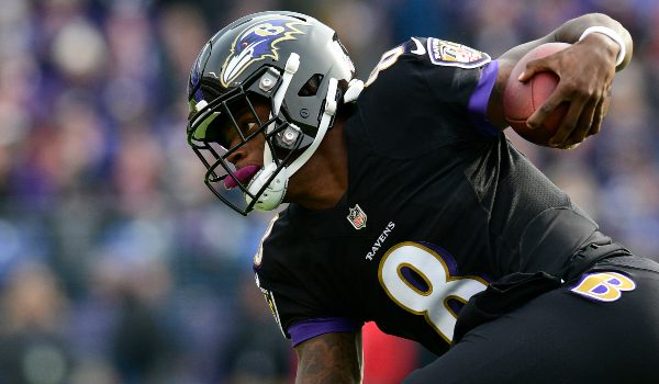 Baltimore Ravens quarterback Lamar Jackson (8) dives for extra yards during the first first quarter against the Cincinnati Bengals at M&T Bank Stadium.