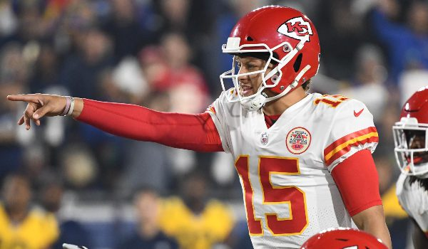 Kansas City Chiefs quarterback Patrick Mahomes (15) and offensive guard Cameron Erving (75) point at the Los Angeles Rams defense during the first quarter at the Los Angeles Memorial Coliseum.