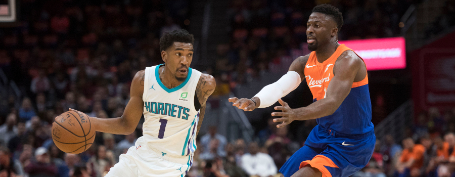 Charlotte Hornets guard Malik Monk (1) Cleveland Cavaliers guard David Nwaba (12) during the first half at Quicken Loans Arena.