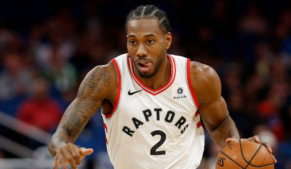 Toronto Raptors forward Kawhi Leonard (2) drives to the basket against the Orlando Magic during the first quarter at Amway Center.