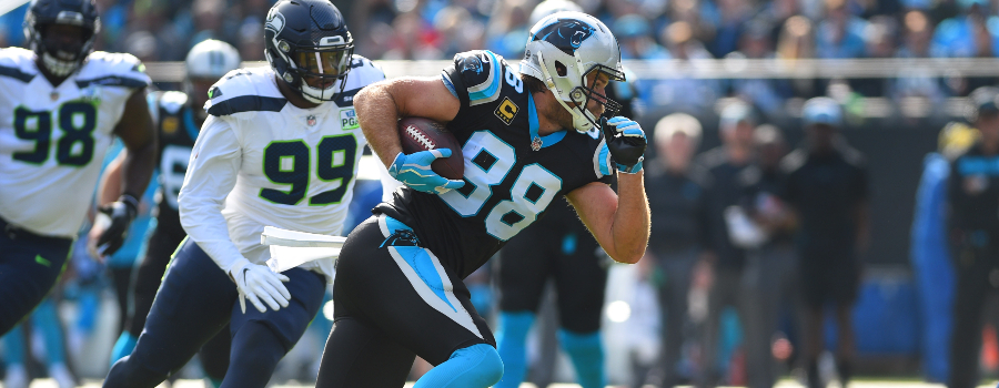 Carolina Panthers tight end Greg Olsen (88) with the ball as Seattle Seahawks defensive tackle Shamar Stephen (98) and defensive end Quinton Jefferson (99) defend in the first quarter at Bank of America Stadium.