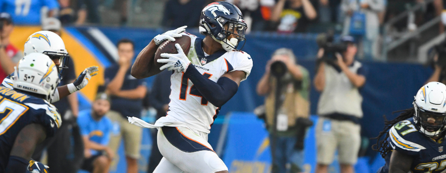 Denver Broncos wide receiver Courtland Sutton (14) grabs a pass between Los Angeles Chargers defenders in the closing seconds of the fourth quarter at StubHub Center. The pass helped the Broncos get to field goal range as they went on to win 23-22.