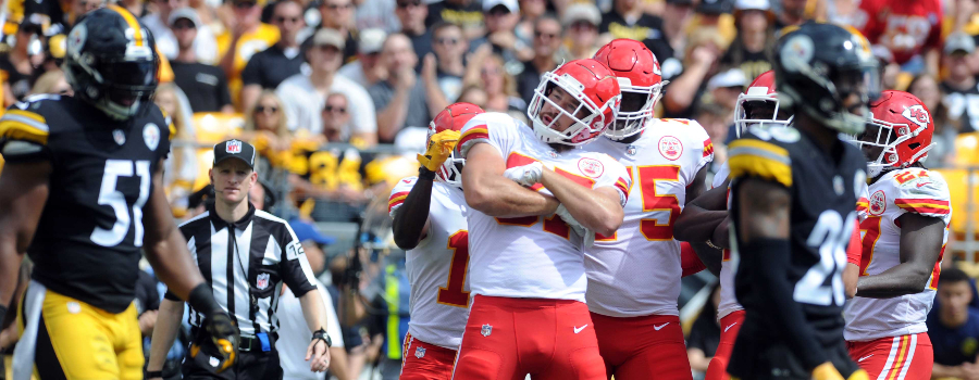 Kansas City Chiefs tight end Travis Kelce (87) celebrates a first quarter touchdown with his teammates as Pittsburgh Steelers linebacker Jon Bostic (51) walks by at Heinz Field.