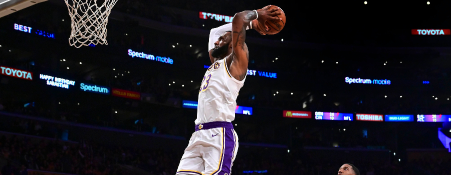 Los Angeles Lakers forward LeBron James (23) flies to the hoop past Phoenix Suns guard De'Anthony Melton (14) during the third quarter at Staples Center.