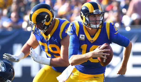 Los Angeles Rams quarterback Jared Goff (16) scrambles out of the pocket in the first half against the Seattle Seahawks at the Memorial Coliseum.
