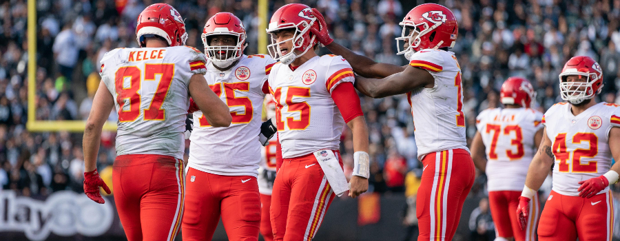 Kansas City Chiefs quarterback Patrick Mahomes (15) celebrates with tight end Travis Kelce (87) after a touchdown against the Oakland Raiders during the third quarter at Oakland Coliseum.