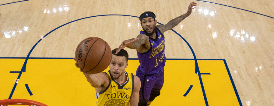 Golden State Warriors guard Stephen Curry (30) shoots the basketball against Los Angeles Lakers forward Brandon Ingram (14) during the first half at Oracle Arena.