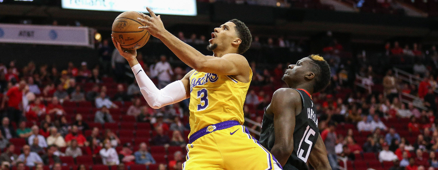 Los Angeles Lakers guard Josh Hart (3) attempts to score as Houston Rockets center Clint Capela (15) defends during the game at Toyota Center.