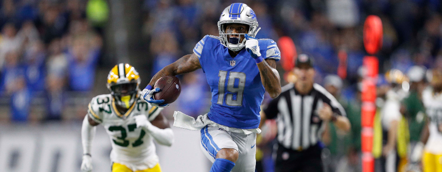 Detroit Lions wide receiver Kenny Golladay (19) runs after a catch during the first quarter against Green Bay Packers cornerback Josh Jackson (37) at Ford Field.