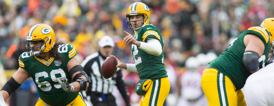 Green Bay Packers quarterback Aaron Rodgers (12) looks to throw a pass during the second quarter against the Arizona Cardinals at Lambeau Field.