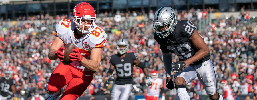 Kansas City Chiefs tight end Travis Kelce (87) scores a touchdown against Oakland Raiders cornerback Daryl Worley (20) during the first quarter at Oakland Coliseum.