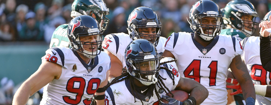 Houston Texans outside linebacker Jadeveon Clowney (90) celebrates with  defensive end J.J. Watt (99) and inside linebacker Zach Cunningham (41) after recovering fumble against the Philadelphia Eagles during the second quarter at Lincoln Financial Field.