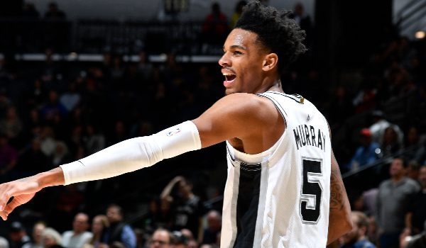 Logan Riely/Getty Images. Pictured: San Antonio Spurs point guard Dejounte Murray (5).