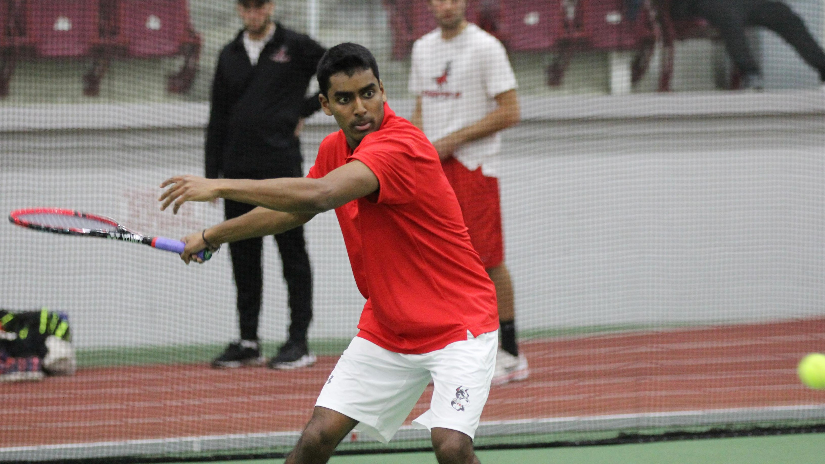 Satyajist Simhadri goes for the forehand