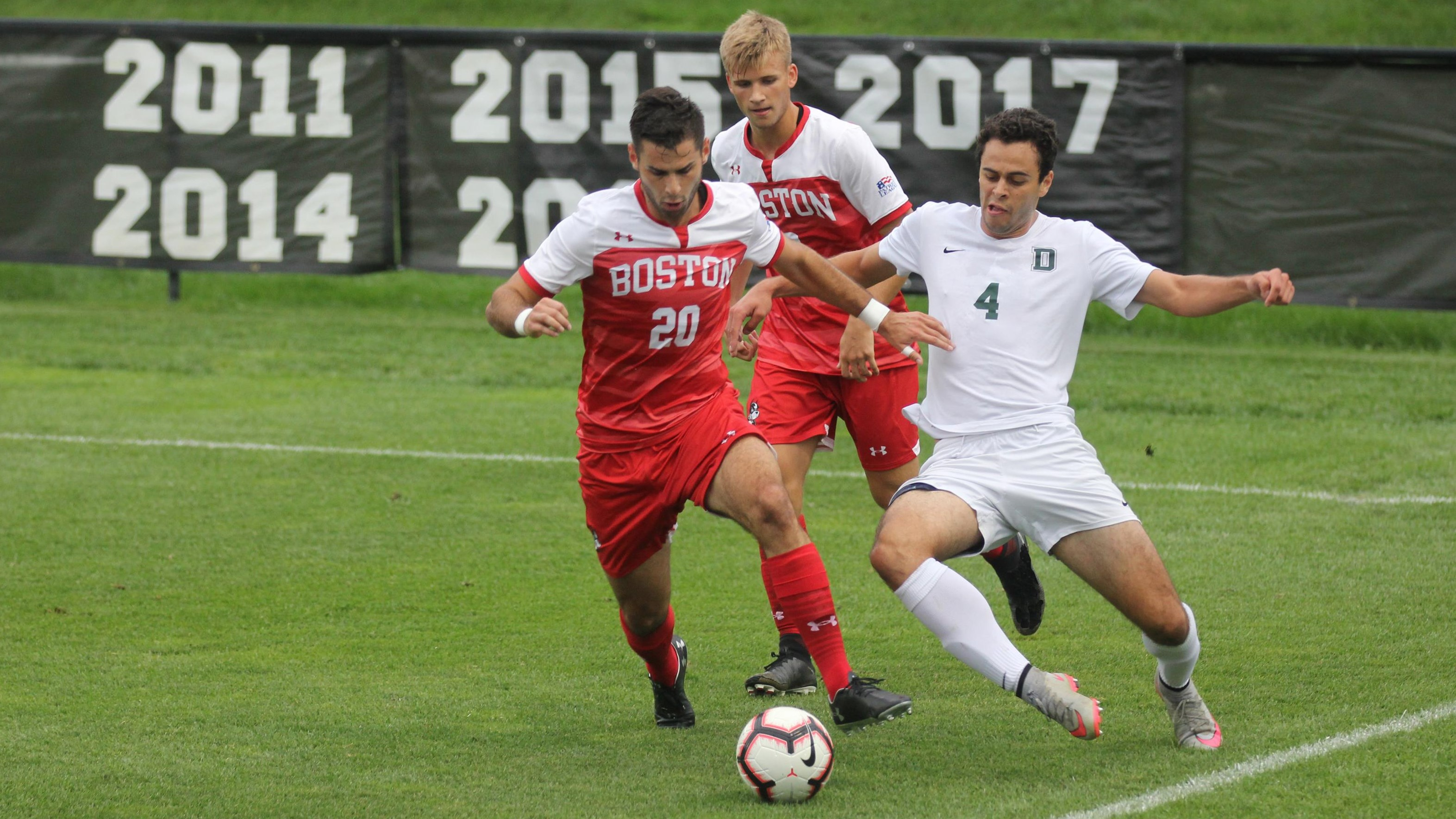 Josh Barkoff gets past a Dartmouth player for possession of the ball with Max Aunger right behind them.
