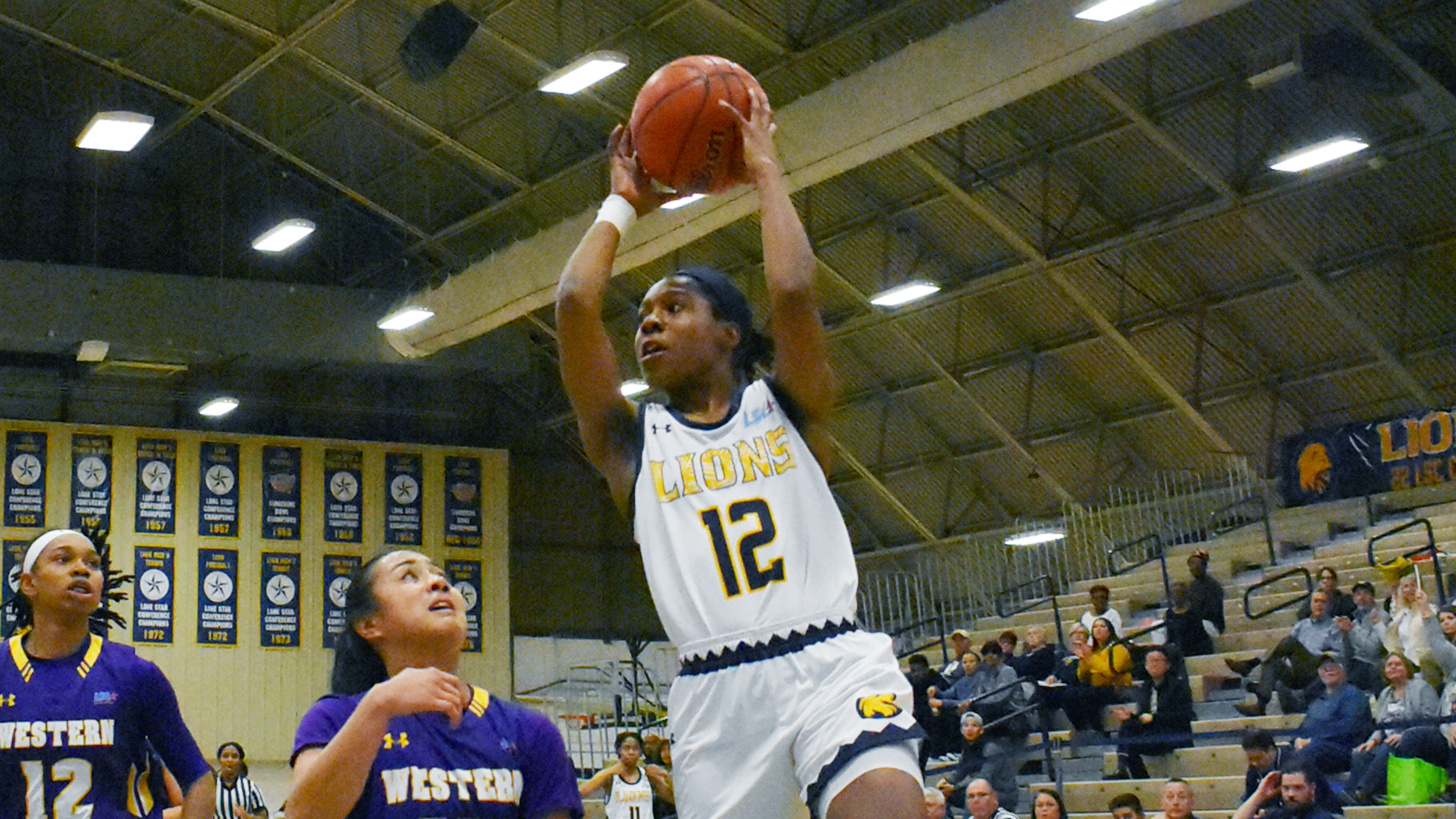 Princess Davis drives against WNMU