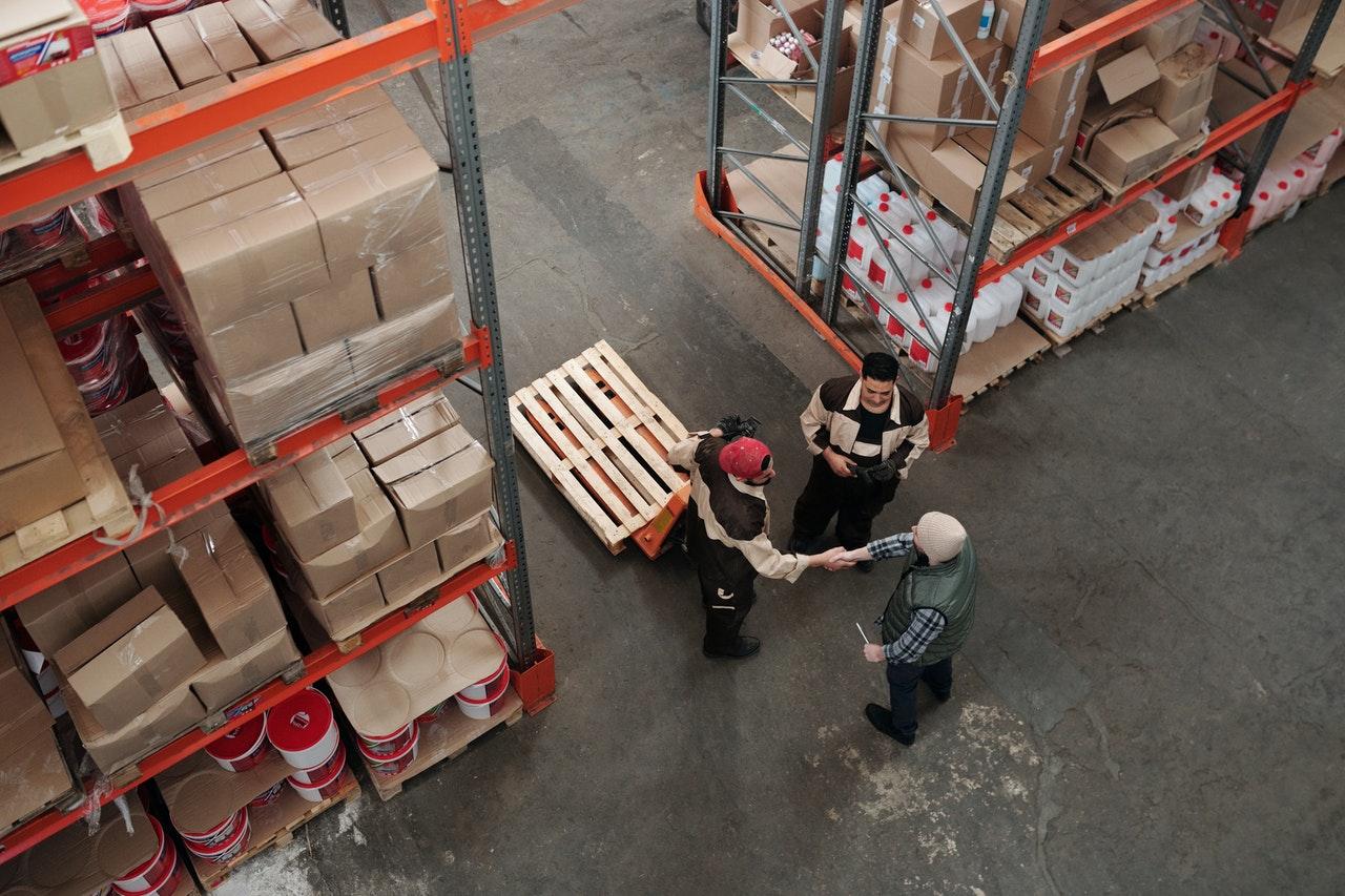 men workin in amazon warehouse