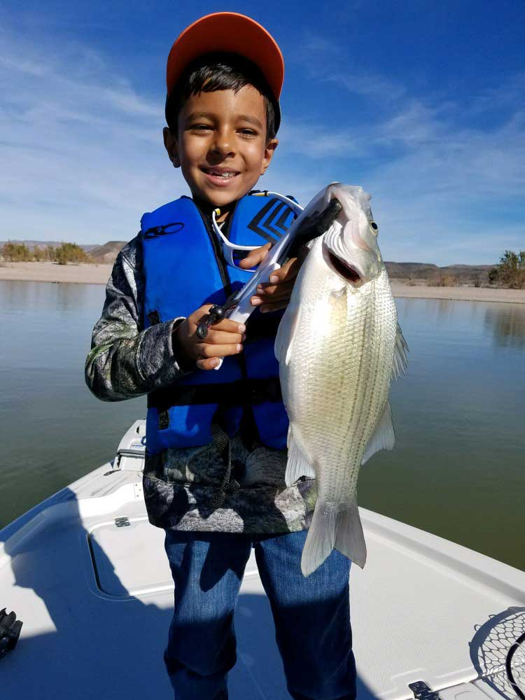 young boy fishing at Elephant Butte Lake