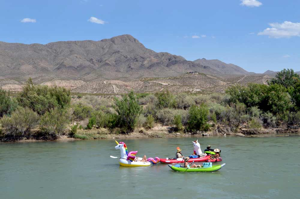 floating down the Rio Grande on innertubes and inflatable rafts - near Truth or Consequences NM
